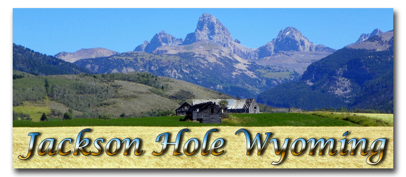 Jackson Hole Wyoming Logo ~ The Grand Tetons or Les Trois Tetons (French for the three breasts) named by trappers. This photograph was taken from the west or Idaho side by Bob Bielski © Copyright All Rights Reserved